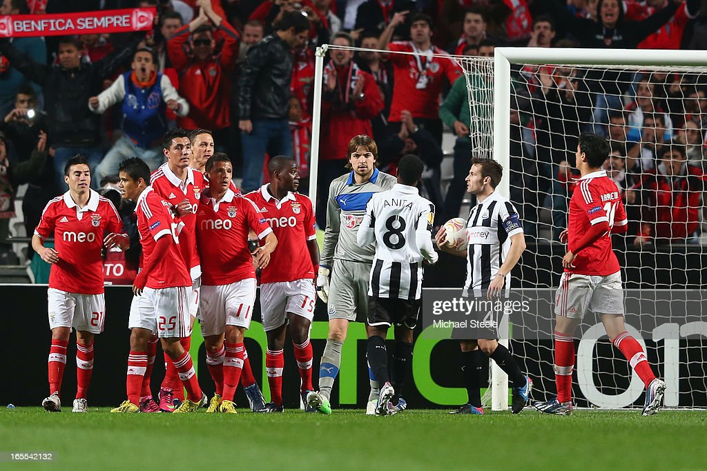 Oscar Cardozo (3L) of Benfica is congratulated after scoring his sides third goal from a penalty during the UEFA Europa League Quarter- Final First Leg match between Benfica and Newcastle United at the Estadio da Luz on April 4, 2013 in Lisbon, Portugal.