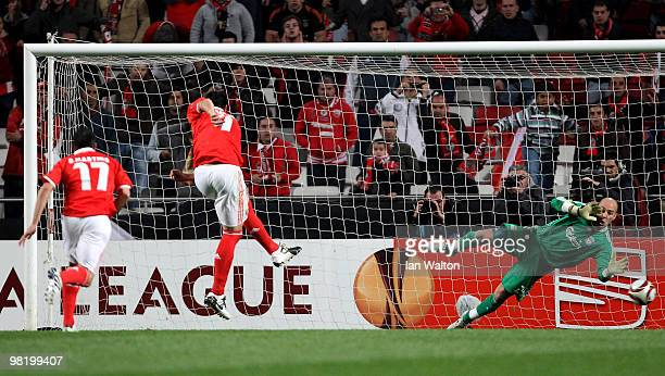 Oscar Cardozo of Benfica scores from the penalty spot past Pepe Reina of Liverpool during the UEFA Europa League quarter final first leg match...