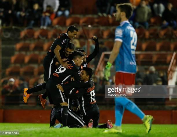 Oscar Cardozo of Libertad celebrates with teammates Jesus Medina Angel Cardozo Lucena and Antonio Bareiro after scoring the opening goal of his team...