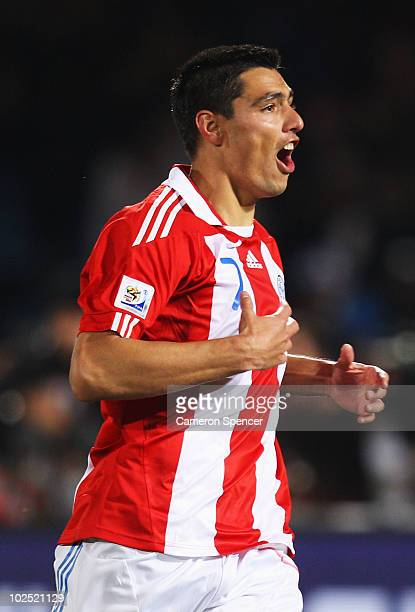 Oscar Cardozo of Paraguay celebrates scoring his penalty as his team win a penalty shootout during the 2010 FIFA World Cup South Africa Round of...