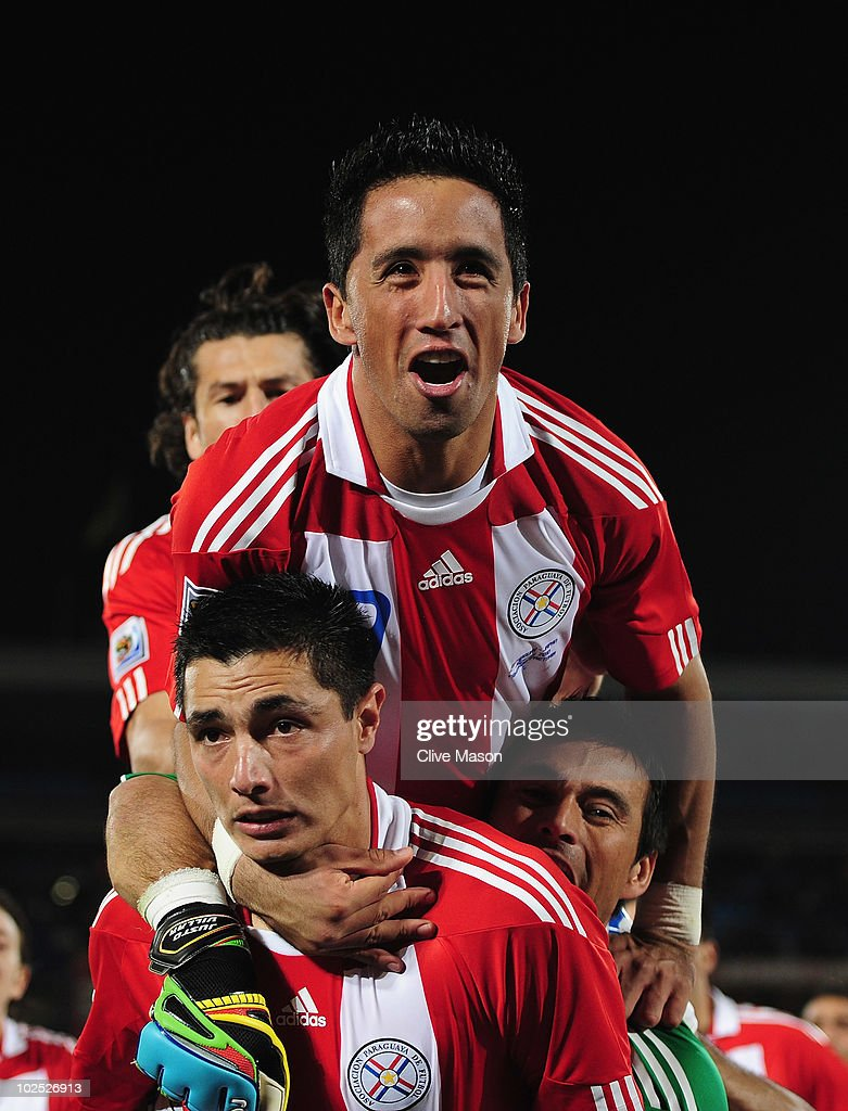 Oscar Cardozo of Paraguay celebrates with team mate Lucas Barrios after scoring his penalty as his team win a penalty shoot-out during the 2010 FIFA World Cup South Africa Round of Sixteen match between Paraguay and Japan at Loftus Versfeld Stadium on June 29, 2010 in Pretoria, South Africa.