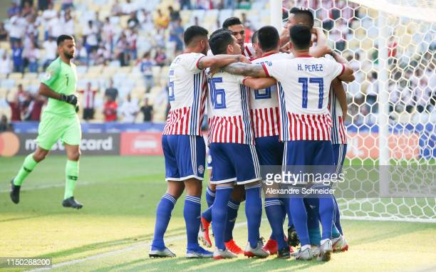 Oscar Cardozo of Paraguay celebrates with teammates after scoring the first goal of his team during the match against Qatar for the Copa America 2019...
