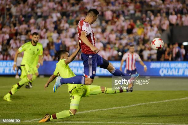 Oscar Cardozo of Paraguay fights for the ball with Yangel Herrera of Venezuela during a match between Paraguay and Venezuela as part of FIFA 2018...