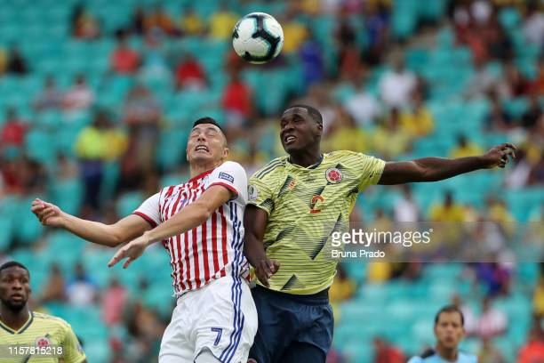 Oscar Cardozo of Paraguay heads for the ball with Cristian Zapata of Colombia during the Copa America Brazil 2019 group B match between Colombia and...