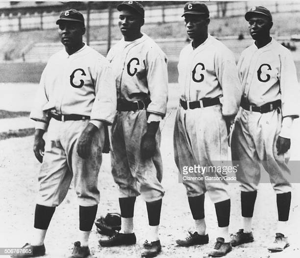 Oscar Charleston, Josh Gibson, Ted Paige and Judy Johnson posing for a group photo during a Negro League baseball game, San Francisco, California,...