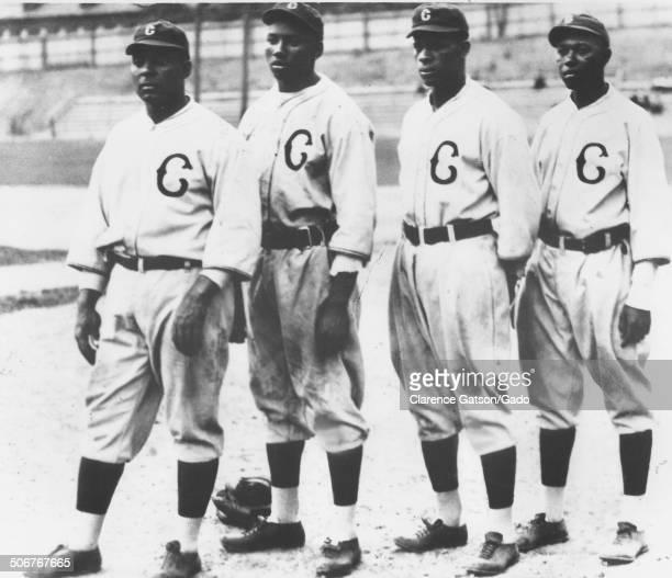 Oscar Charleston, Josh Gibson, Ted Paige and Judy Johnson posing for a group photo during a Negro League baseball game, San Francisco, California,...