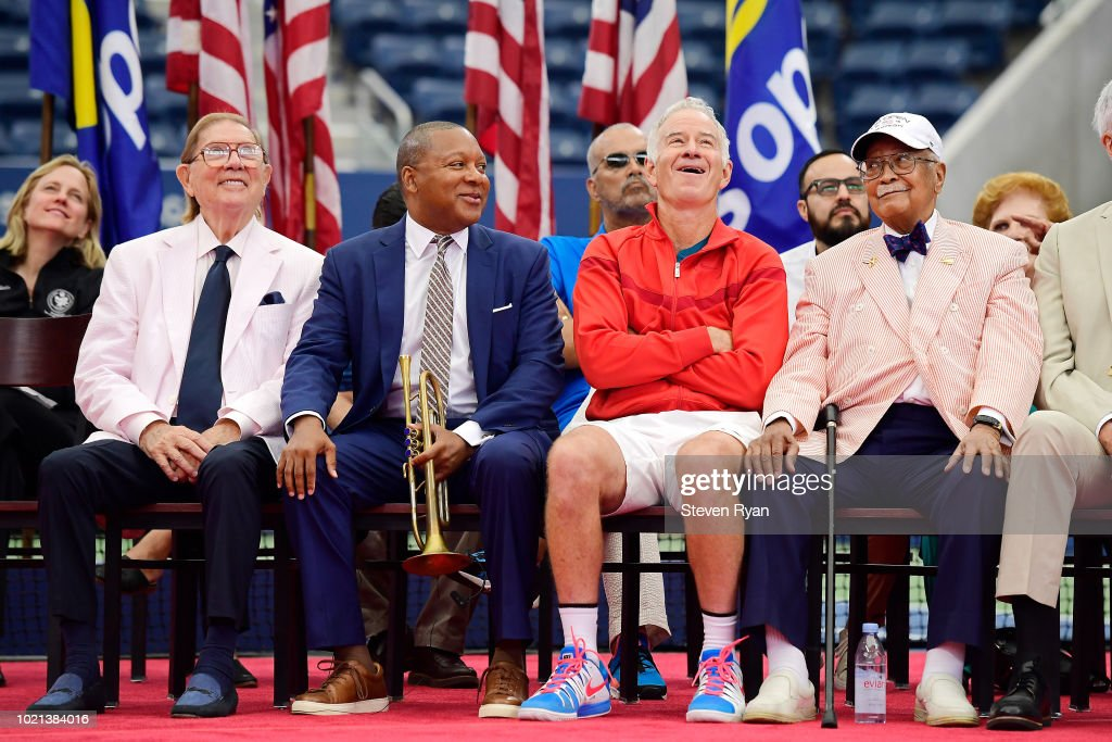 Oscar Cohen, Wynton Marsalis, John McEnroe and David Dinkins react to a tribute video during the Louis Armstrong Stadium Dedication Ceremony at USTA Billie Jean King National Tennis Center on August 22, 2018 in New York City.