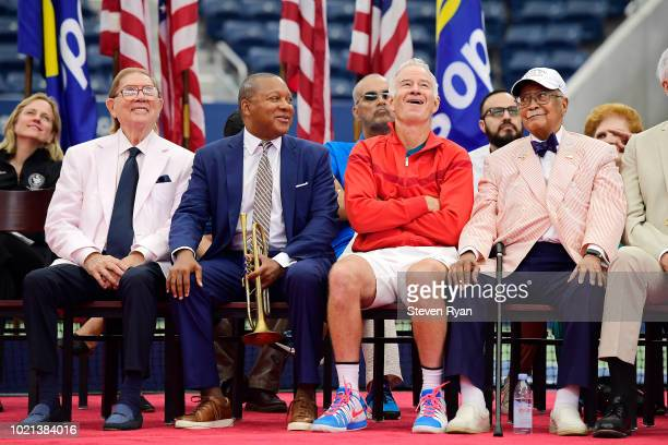 Oscar Cohen, Wynton Marsalis, John McEnroe and David Dinkins react to a tribute video during the Louis Armstrong Stadium Dedication Ceremony at USTA...