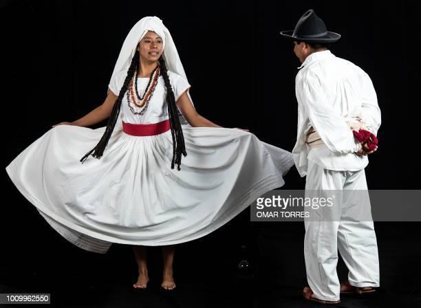Oscar Cruz and Acela Cristina Ruiz from Tecocuilco rehearse for the Guelaguetza traditional festival in Oaxaca Mexico on July 28 2018 Guelaguetza has...