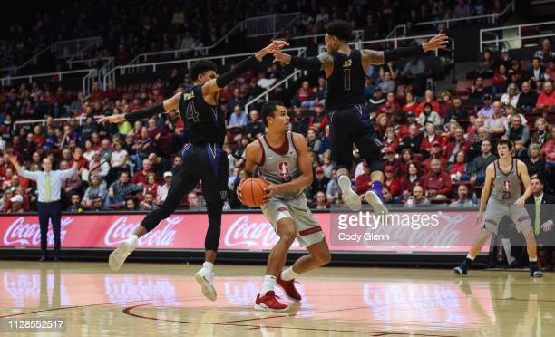 Oscar Da Silva of the Stanford Cardinal is defended by Matisse Thybulle of the Washington Huskies and David Crisp of the Washington Huskies during...