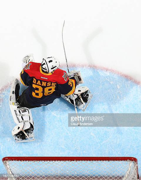 Oscar Dansk of the Erie Otters faces shots in the warmup prior to an OHL game against the London Knights on September 21 2012 at the Budweiser...
