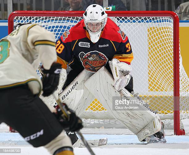 Oscar Dansk of the Erie Otters gets set to face a shot in an OHL game against the London Knights on October 19 2012 at the Budweiser Gardens in...