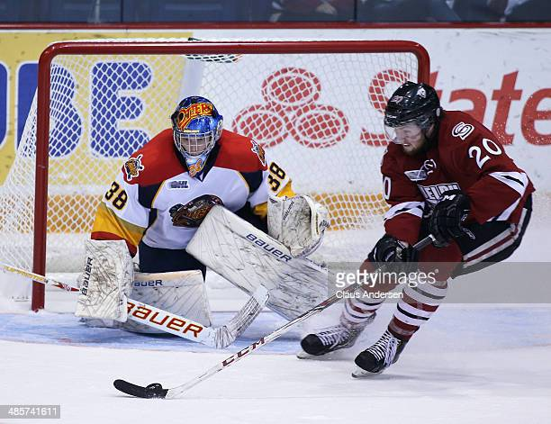 Oscar Dansk of the Erie Otters watches for a tipped shot from Justin Auger of the Guelph Storm in Game Two of the OHL Western Conference Final at the...