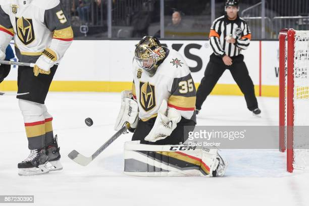 Oscar Dansk of the Vegas Golden Knights makes a save against the Colorado Avalanche during the game at TMobile Arena on October 27 2017 in Las Vegas...