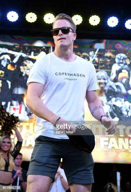 Oscar Dansk of the Vegas Golden Knights throws a hat to the crowd as he is introduced at the team's 'Stick Salute to Vegas and Our Fans' event at the...