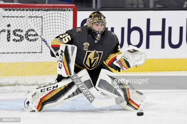 Oscar Dansk of the Vegas Golden Knights warms up prior to the game against the Chicago Blackhawks at TMobile Arena on October 24 2017 in Las Vegas...