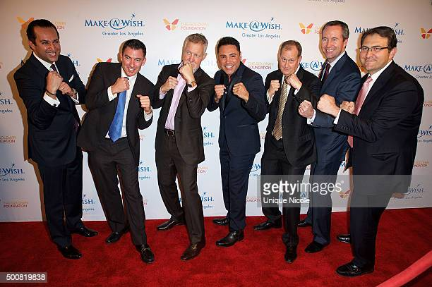 Oscar De la Hoya and event auctioneers arrive at the MakeAWish Greater Los Angeles Annual Wishing Well Winter Gala at the Beverly Wilshire Four...