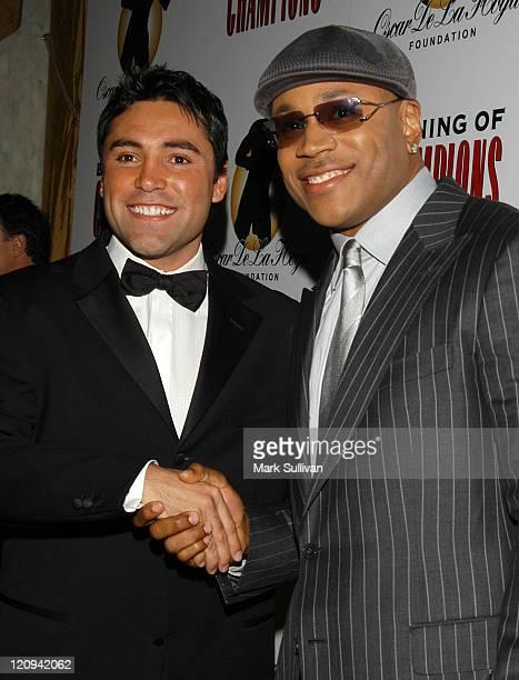 Oscar De La Hoya and LL Cool J during Oscar De La Hoya Hosts 7th Annual Evening of Champions at The Regent Beverly Wilshire Hotel in Beverly Hills,...
