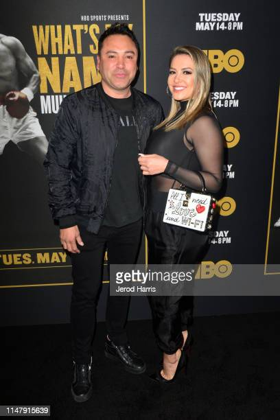 Oscar De La Hoya and Millie Corretjer attend Premiere of HBO's 'What's My Name Muhammad Ali' at Regal Cinemas LA LIVE Stadium 14 on May 08 2019 in...