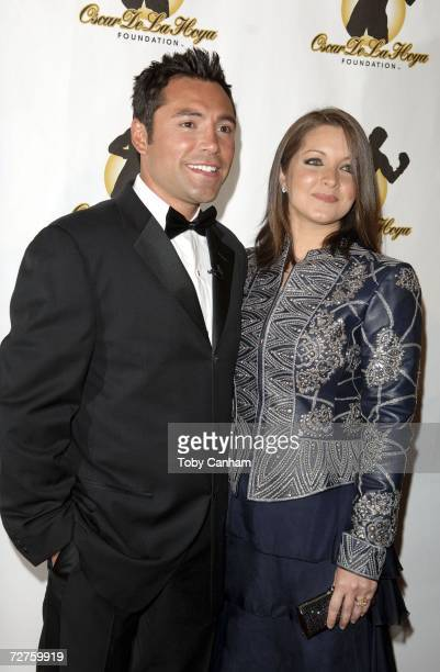 Oscar De la Hoya and Millie Corretjer pose for a picture at the Oscar De La Hoya Foundation Evening of Champions held at the Beverly Hilton Hotel...