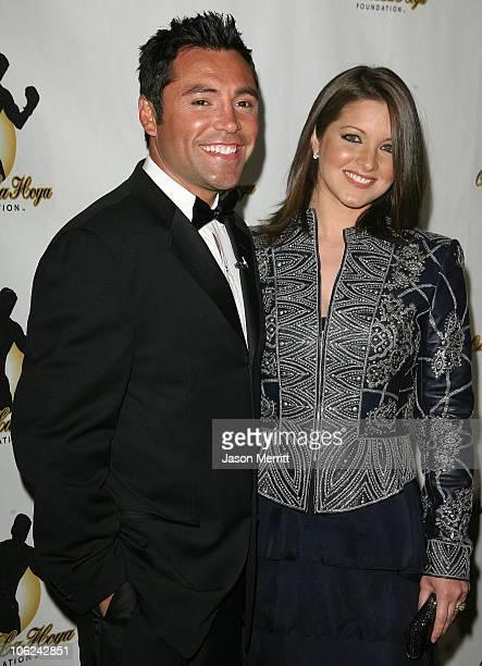 Oscar De La Hoya and wife Millie Corretjer during The 2006 Oscar De La Hoya Foundation Evening of Champions Arrivals at Beverly Hilton Hotel in...