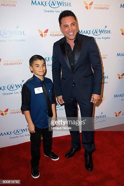 Oscar De La Hoya and 'wish kid' arrive at MakeAWish Greater Los Angeles honors Oscar De La Hoya Michael Rosenfeld and Tom Mone at its annual Wishing...