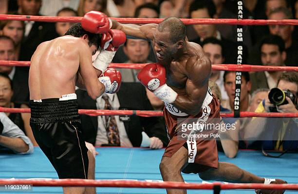 Oscar de la Hoya black trunks fights Bernard Hopkins red trunks during a WBC/WBA/IBF middleweight title fight at the MGM Grand Garden Arena in Las...