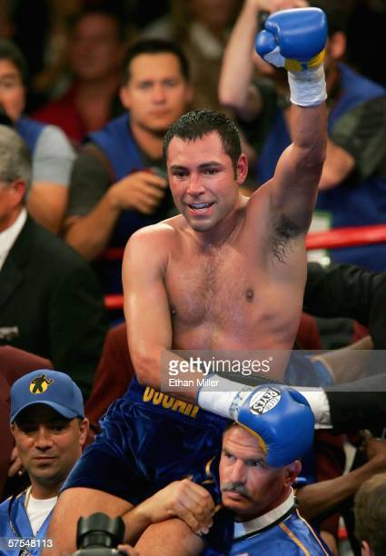 Oscar De La Hoya celebrates after defeating Ricardo Mayorga during the WBC super welterweight title fight at the MGM Grand Garden Arena May 6, 2006...