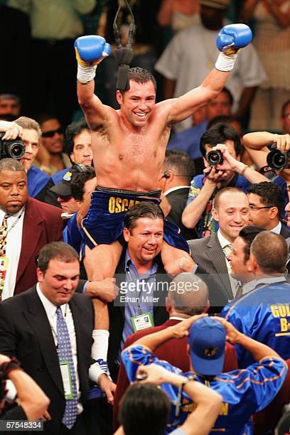 Oscar De La Hoya celebrates after defeating Ricardo Mayorga during the WBC super welterweight title fight at the MGM Grand Garden Arena May 6 2006 in...