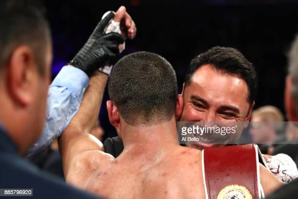 Oscar De La Hoya congratulates Sadaam Ali after defeating Miguel Cotto in their Junior Middleweight bout at Madison Square Garden on December 02 2017...