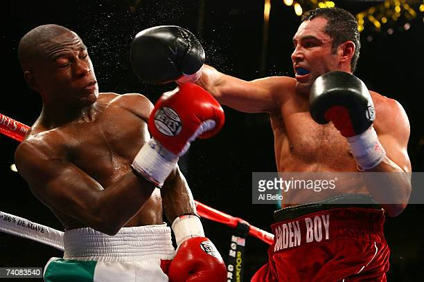 Oscar De La Hoya connects with a right to the face of Floyd Mayweather Jr. During their WBC super welterweight championship fight at the MGM Grand...