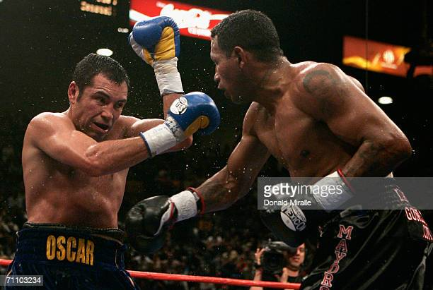 Oscar De La Hoya fights against Ricardo Mayorga during the WBC super welterweight title fight at the MGM Grand Garden Arena May 6, 2006 in Las Vegas,...
