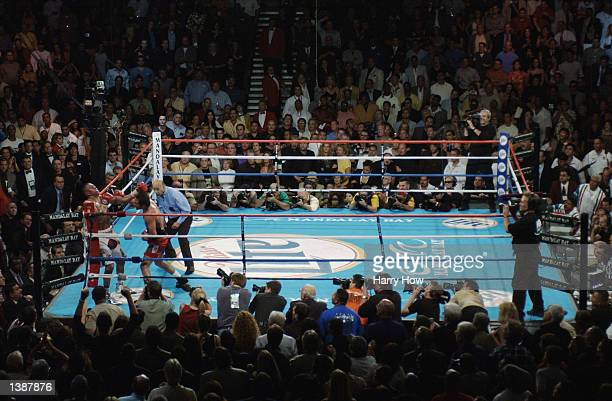 Oscar De La Hoya gets Fernando Vargas in the corner in the 11th round during their world super welterweight/Jr middleweight championship fight at the...