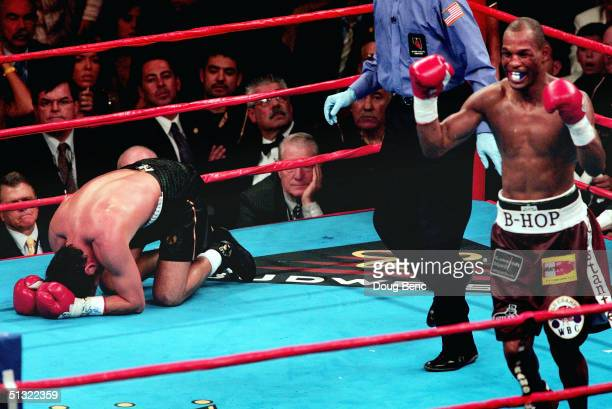 Oscar De La Hoya goes to his knees after being knocked out by a celebratory Bernard Hopkins R for the world middleweight title at the MGM Grand...