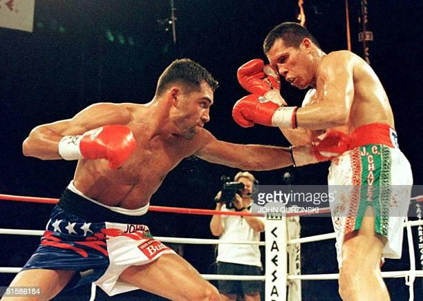 Oscar de la Hoya lands a left against WBC Super Lightweight Champion Julio Cesar Chavez in the thirdround 07 June at Caesars Palace in Las Vegas De...