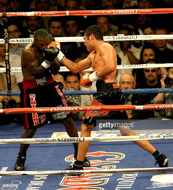 Oscar De La Hoya lands a punch on the face of Steve Forbes during the junior middleweight bout at the Home Depot Center on May 3 2008 in Carson...