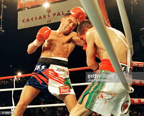 Oscar de la Hoya of the United States punches WBC Super Lightweight champion Julio Cesar Chavez of Mexico into the ropes during the fourth round of...