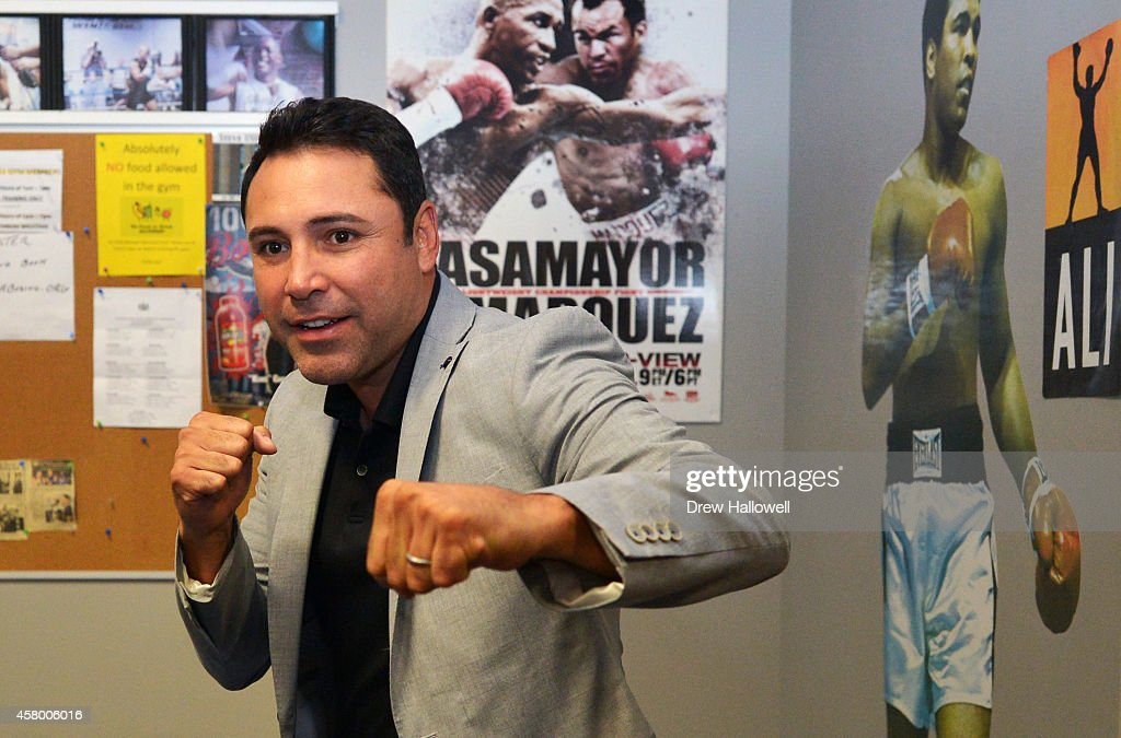 Oscar De La Hoya poses for a photo before Bernard Hopkins works out for the media at Joe Hand Boxing Gym on October 28, 2014 in Philadelphia, Pennsylvania.