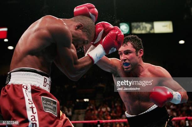 Oscar De La Hoya R fights Bernard Hopkins for the world middleweight title at the MGM Grand Garden Arena on September 18 2004 in Las Vegas Nevada...