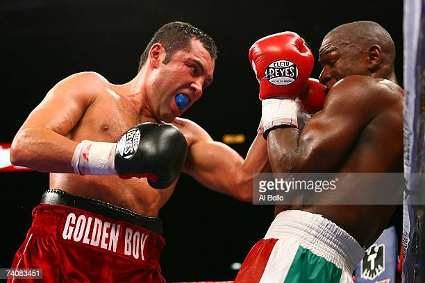 Oscar De La Hoya throws a left to the face of Floyd Mayweather Jr. As he is against the ropes during their WBC super welterweight championship fight...