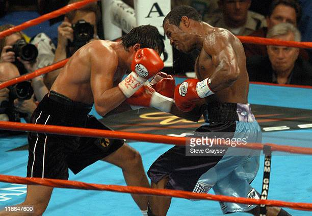 a3c45b05e674 Oscar De La Hoya tries to duck from a Shane Mosley blow