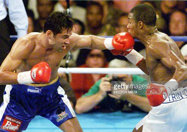 Oscar de la Hoya , WBC Welterweight champion from the US, lands a left against Felix Trinidad, IBF Welterweight champion from Puerto Rico during 2nd...