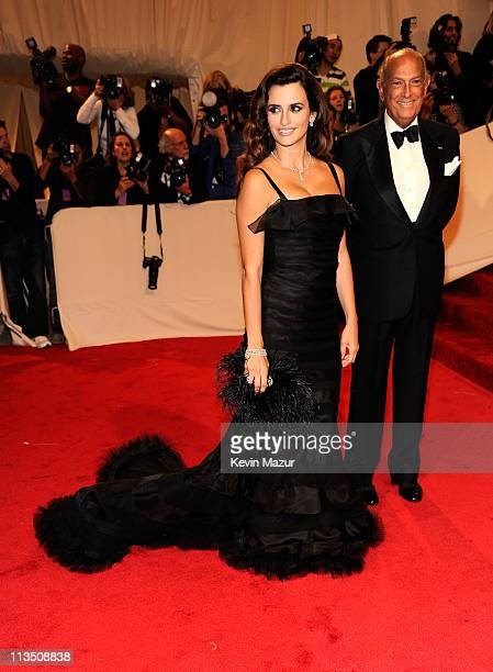 "Oscar De La Renta and Penelope Cruz attends the ""Alexander McQueen: Savage Beauty"" Costume Institute Gala at The Metropolitan Museum of Art on May 2,..."