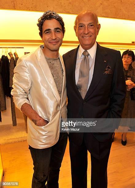 Oscar de la Renta and Zac Posen attend the Oscar de la Renta Fashion's Night Out party at the Oscar de la Renta Boutique on September 10 2009 in New...
