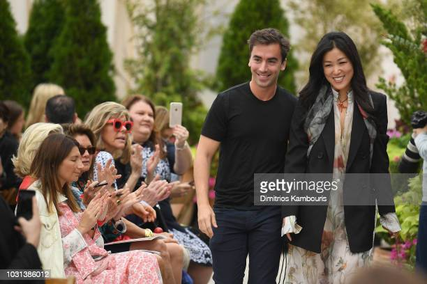Oscar De La Renta creative directors Fernando Garcia and Laura Kim greet the audience at the Oscar De La Renta front Row during New York Fashion Week...