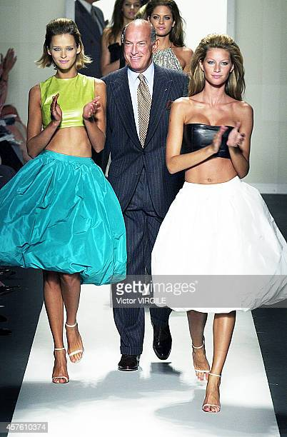 Oscar de la Renta Karmen Kass and Gisele Bundchen walk the runway at the end of the Oscar de la Renta Ready to Wear Spring Summer 2001 show in...