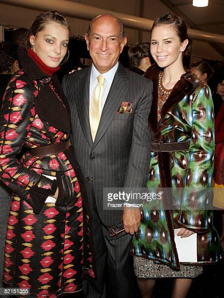 Oscar De La Renta poses with models backstage during the Oscar De La Renta Fall 2005 fashion show during Olympus Fashion Week February 7 2005 in New...