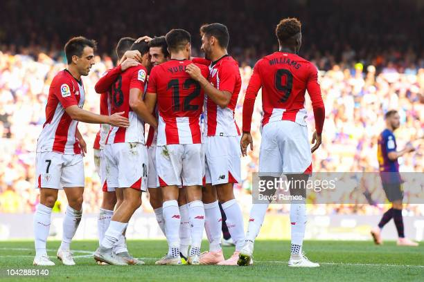 Oscar de Marcos celebrates with his team matea after scoring his team's first goal of Athletic Club during the La Liga match between FC Barcelona and...