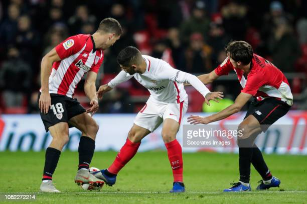 Oscar de Marcos of Athletic Bilbao Ever Banega of Sevilla FC Ander Iturraspe of Athletic Bilbao during the La Liga Santander match between Athletic...