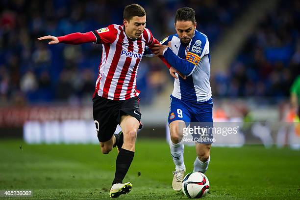 Oscar de Marcos of Athletic Club and Sergio Garcia of RCD Espanyol fight for the ball during the Copa del Rey SemiFinal Second Leg match between RCD...